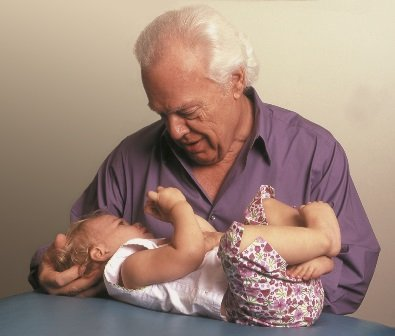 John Upledger treating his grandchild